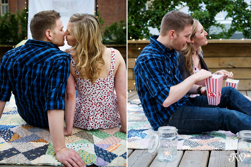 Rooftop-movie-Calgary-engagement-session-couple-eating-popcorn