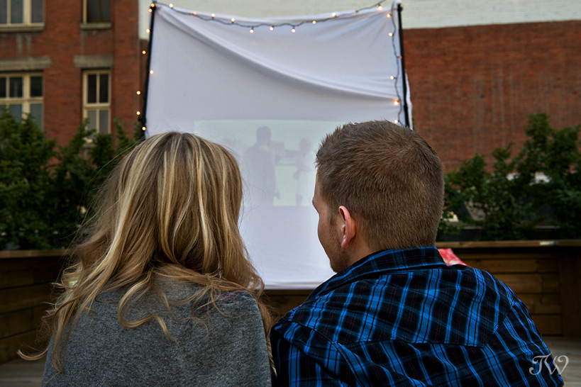 Rooftop-movie-Calgary-engagement-session-couple-watching-movie