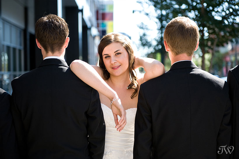 Calgary-wedding-photographer-at-hotel-arts-bride-and-groomsmen