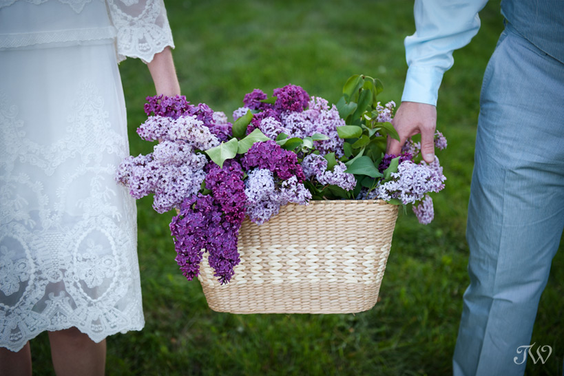 Calgary-engagement-photographs-bride-groom-holding-lilacs
