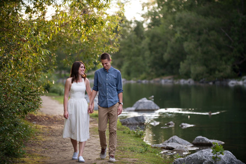 couple on the bow river Calgary engagement photography