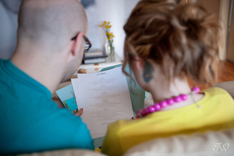 Clients view the price list at consult with Tara Whittaker Photography
