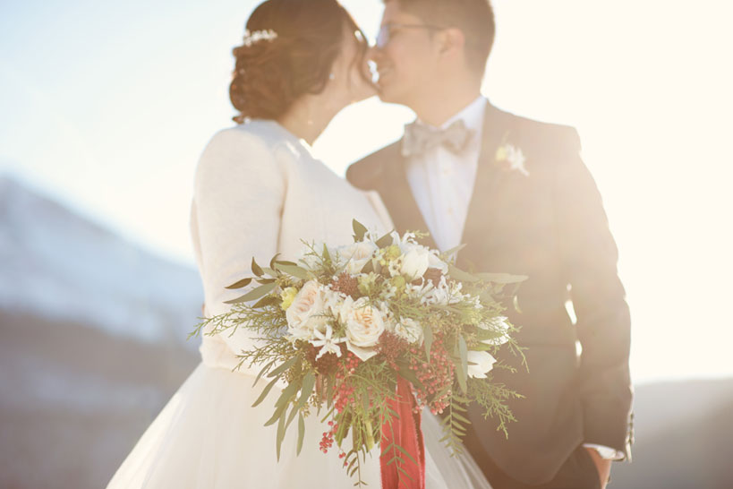 bride and groom first kiss captured by Calgary wedding photographer Tara Whittaker