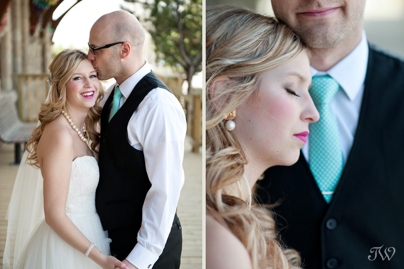 groom kissing bride's forehead captured by Tara Whittaker Photography