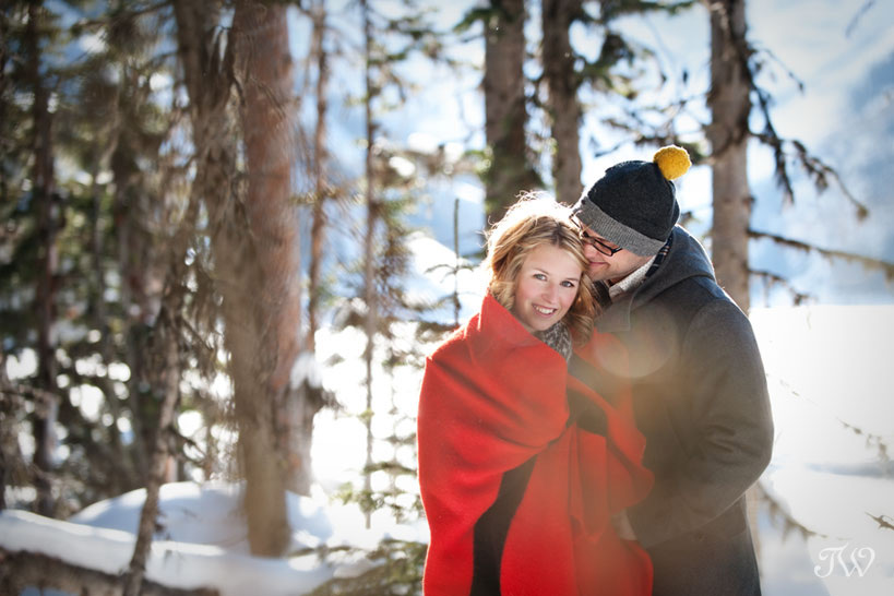 bride & groom wrapped in a red blanket captured by Tara Whittaker Photography