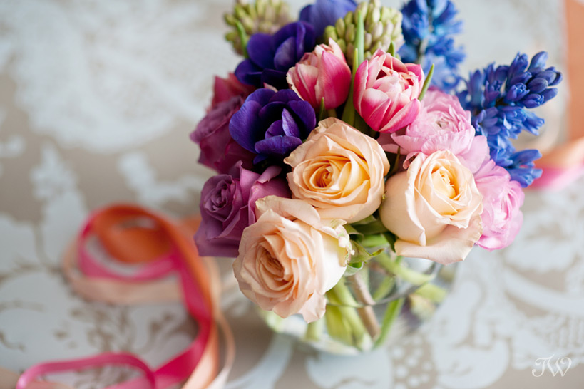 colourful spring wedding bouquets using pink ranunculus Tara Whittaker Photography