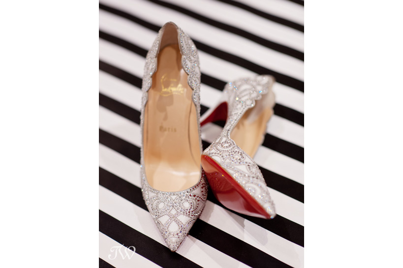 A pair of Christian Louboutin bridal shoes photographed by Tara Whittaker
