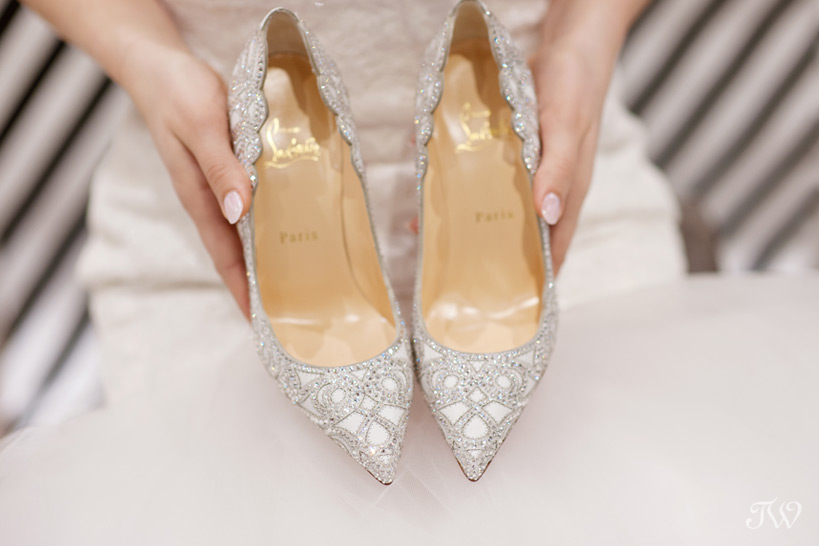 bride holding a pair of shoes Tara Whittaker Photography