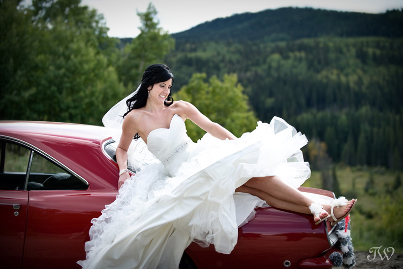 bride on a red car red wedding ideas
