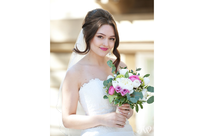 bride carrying a spring bouquet