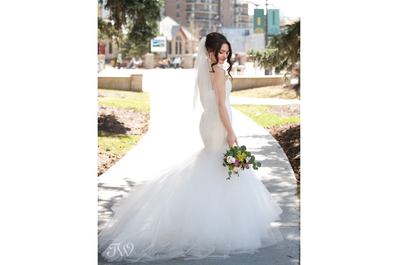 bride in a Romona Keveza gown
