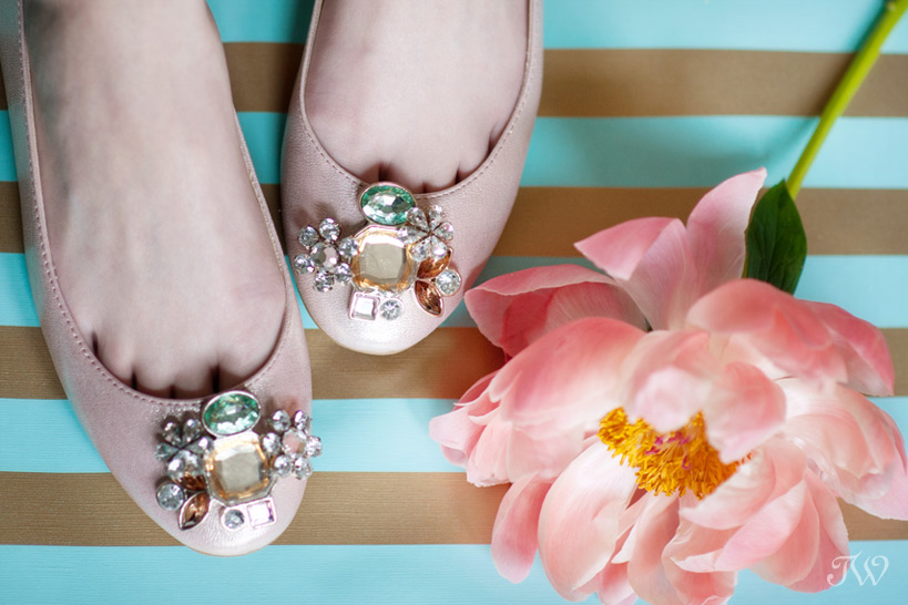 pair of bridal ballet flats in pink captured by Tara Whittaker Photography