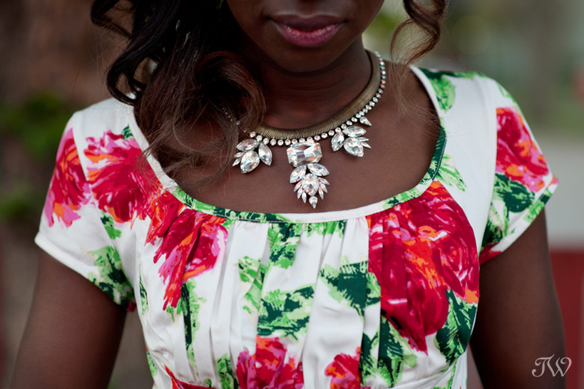 bridesmaid wears a statement necklace captured by Tara Whittaker Photography