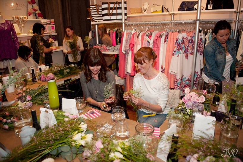 attendees making flower arrangements