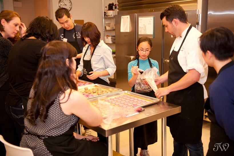 Chef at Ollia teaching how to make macarons