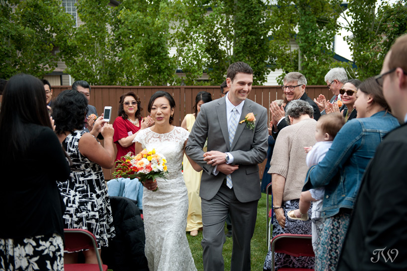 newlywed couple at their backyard wedding captured by Tara Whittaker Photography