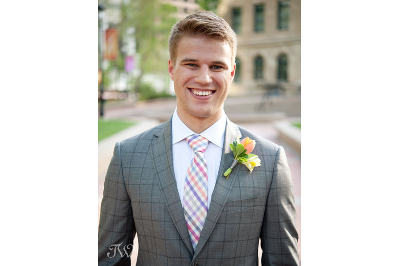 Smiling groom in a checked tie captured by Tara Whittaker Photography