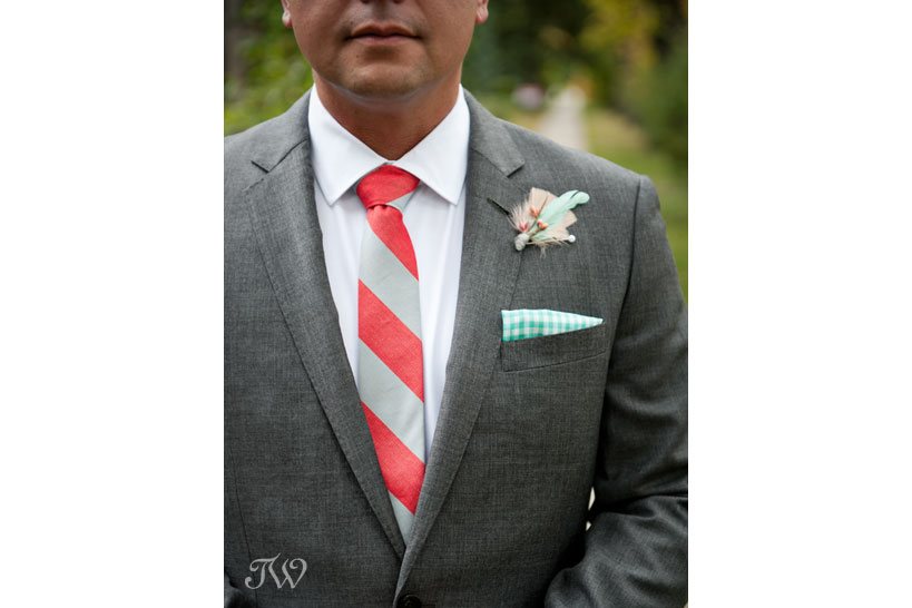 Boutonniere made from feathers captured by Tara Whittaker Photography