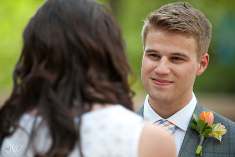 groom glances at his bride captured by Tara Whittaker Photography