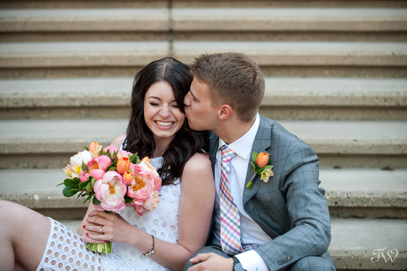 grooms kisses his bride on the cheek captured by Tara Whittaker Photography