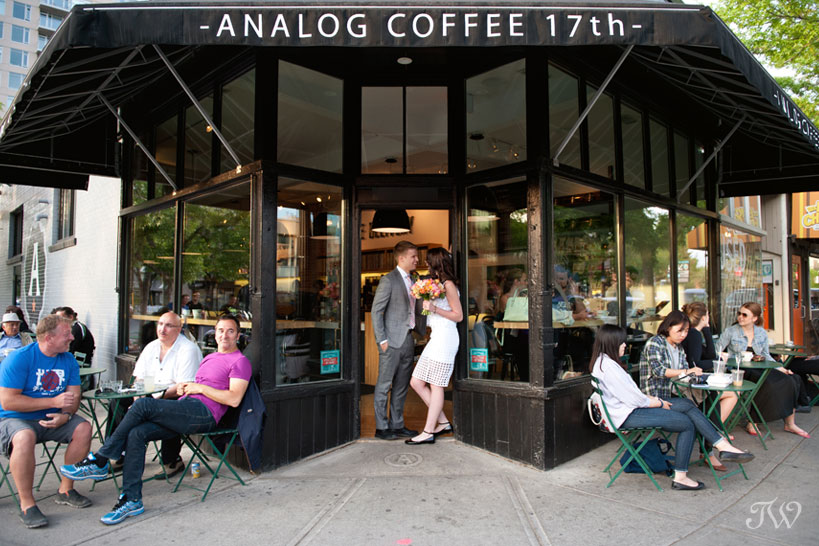 bride and groom pose at their favourite coffee shop