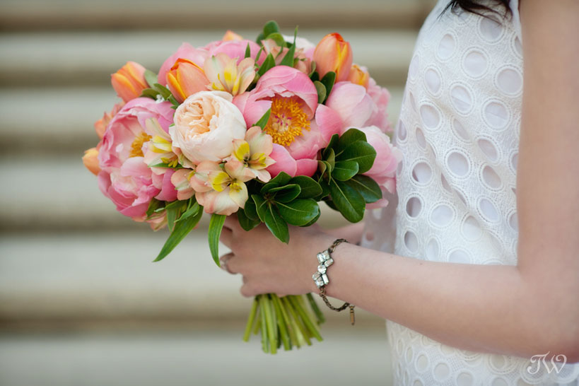 bride holding peony bouquet captured by Tara Whittaker Photography