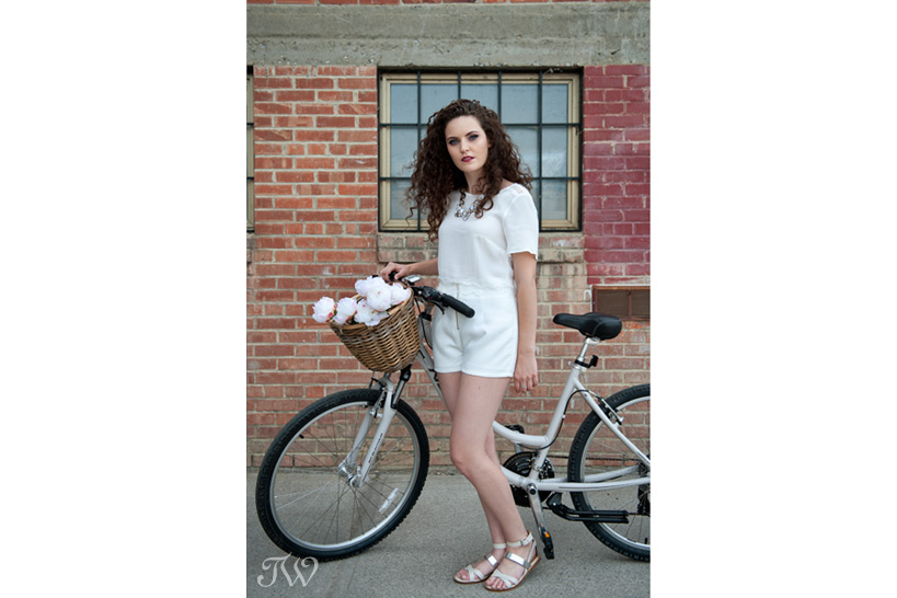 model with a white bike captured by Tara Whittaker Photography