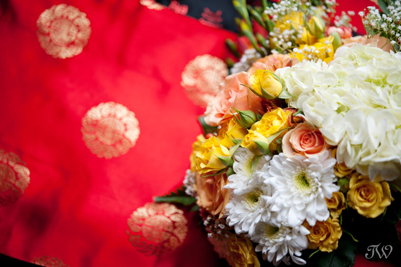 a bridal bouquet in orange and yellow captured by Tara Whittaker Photography