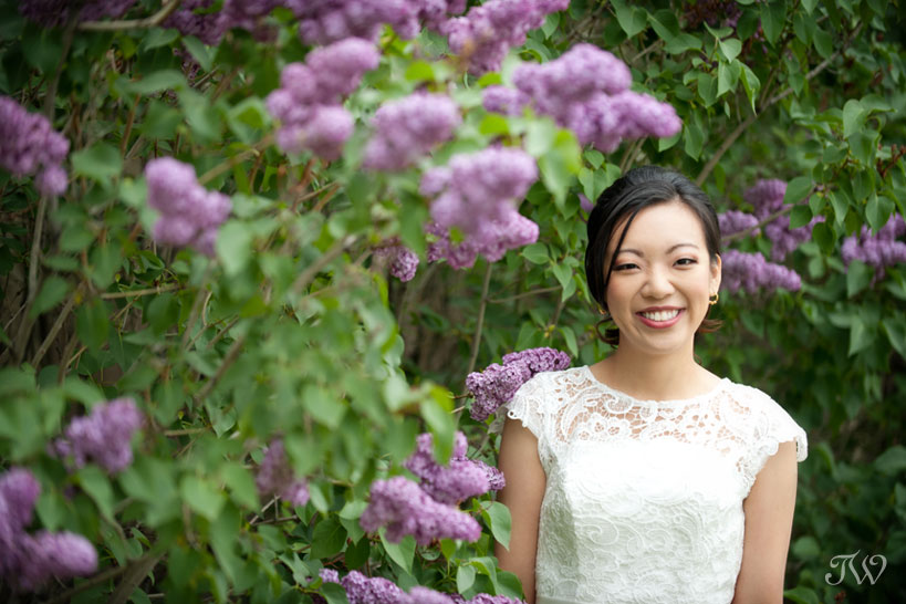 bride with lilacs in bloom captured by Tara Whittaker Photography