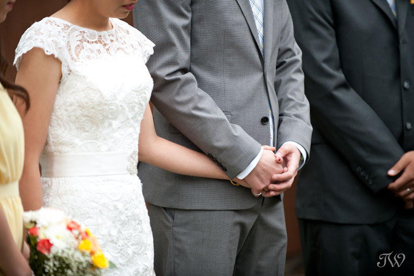 holding hands during wedding ceremony captured by Tara Whittaker Photography