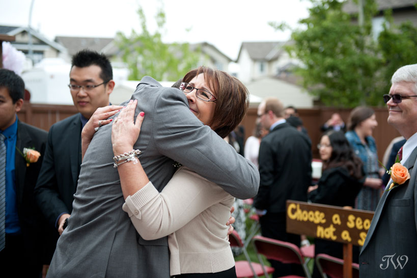 groom and his mother hug captured by Tara Whittaker Photography