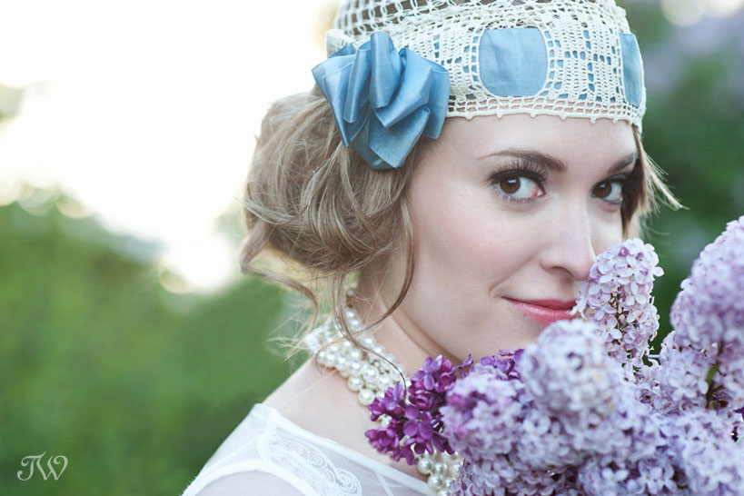 bride holding purple lilacs captured by Tara Whittaker Photography