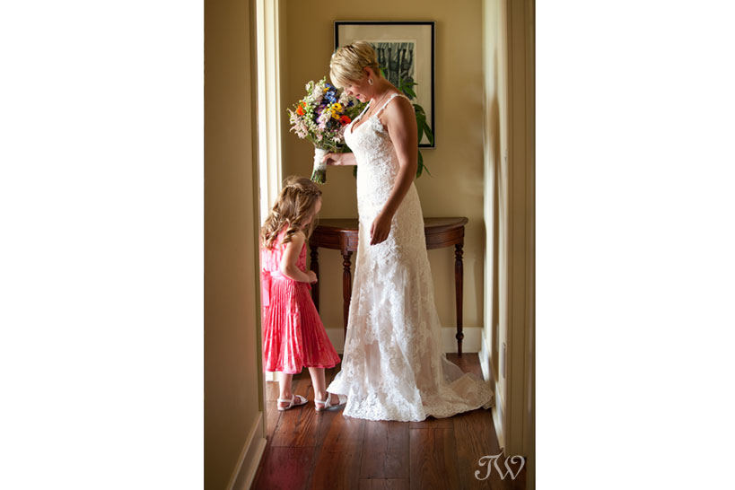 bride and flowers girl captured by Tara Whittaker Photography