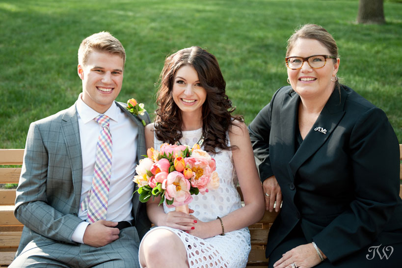 Wedding officiant Jacqueline Hoare poses with a bride and groom