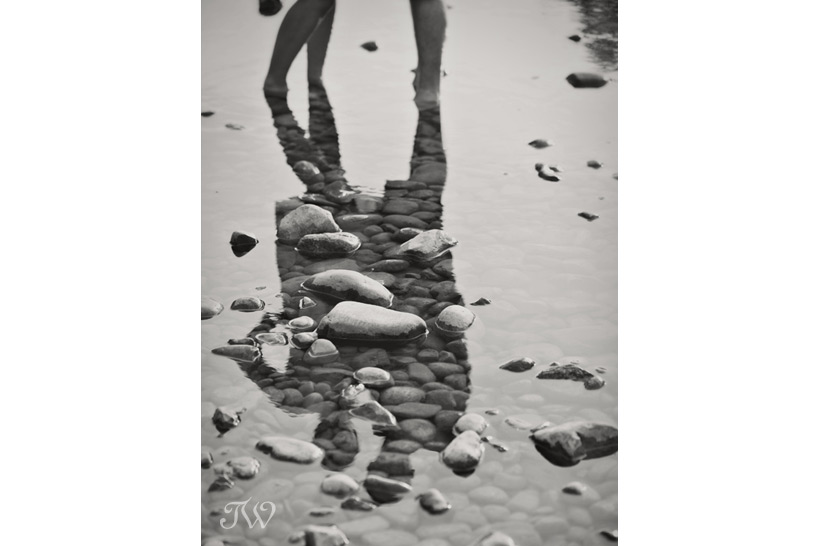 reflection of couple on water captured by Tara Whittaker Photography