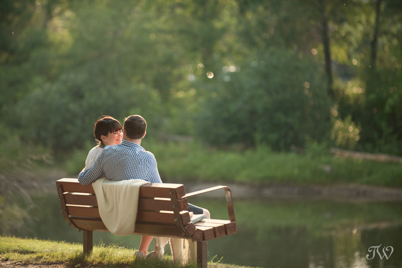 couple on a park bench captured by Tara Whittaker Photography