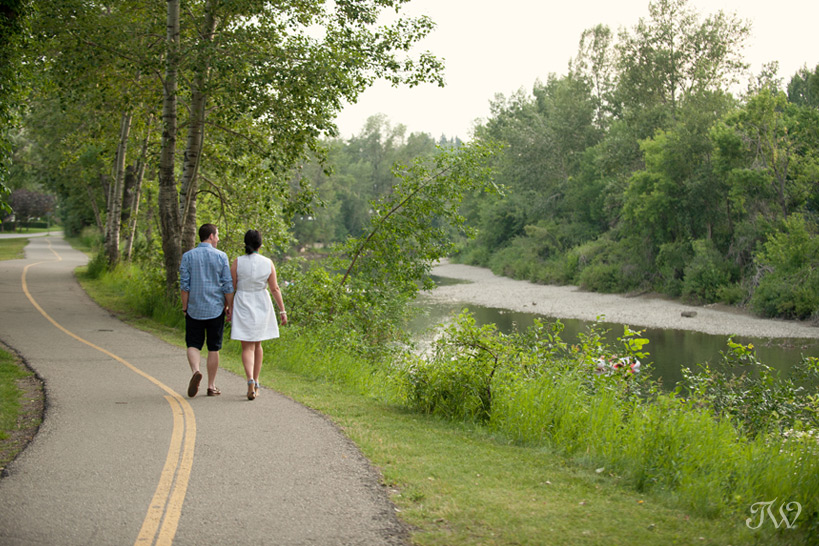 couple walking on the river pathway captured by Tara Whittaker Photography
