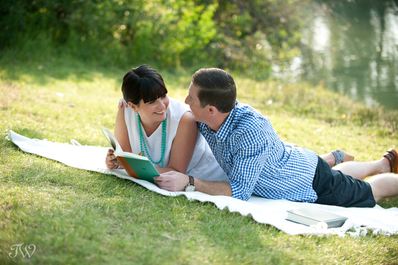 couple reading in Stanley Park captured by Tara Whittaker Photography