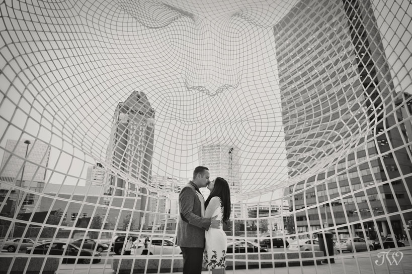 engaged couple at Bow Building Calgary captured by Tara Whittaker Photography