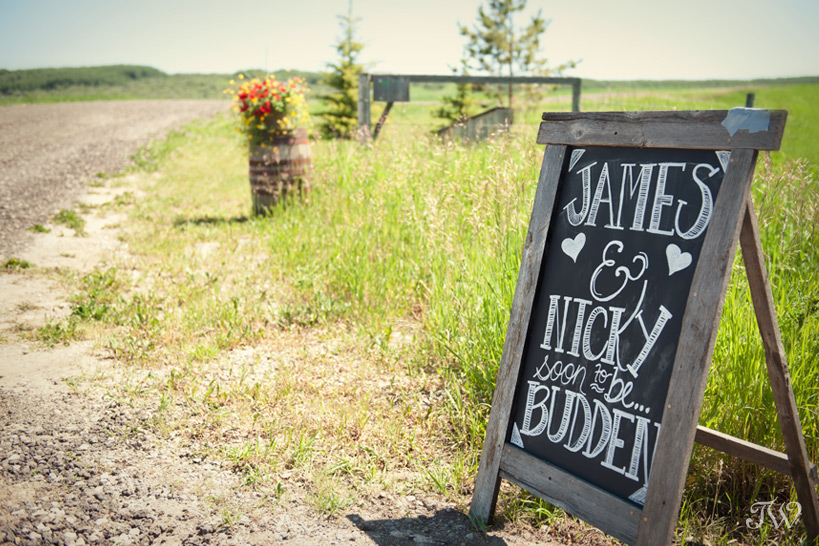 chalkboard sign at ranch wedding captured by Tara Whittaker Photography