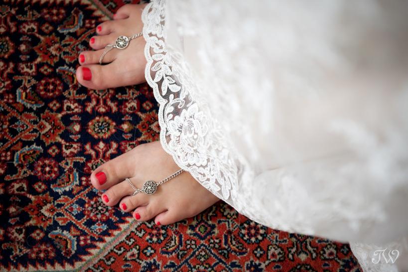 bride wearing barefoot sandals at her Okotoks wedding captured by Tara Whittaker Photography
