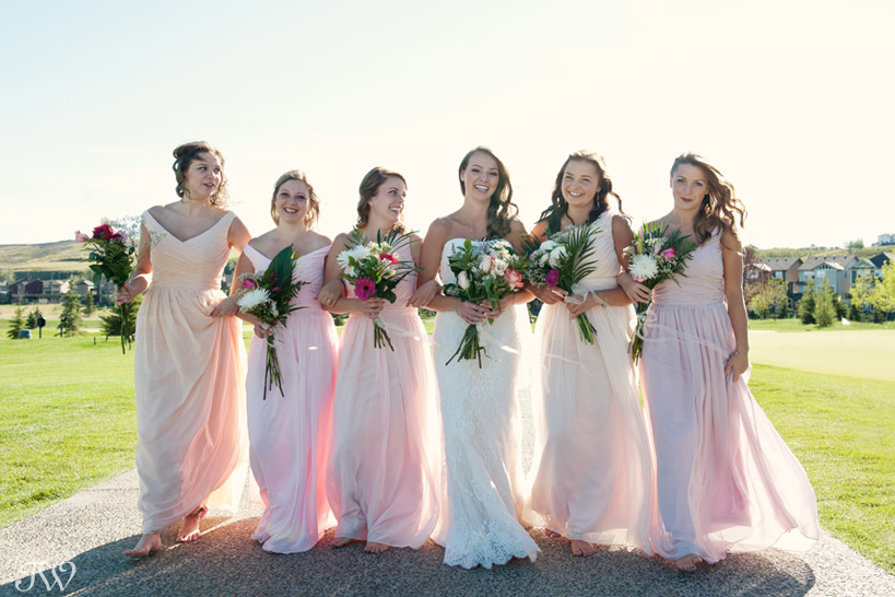 bride and bridesmaids in pretty pastel shades captured by Tara Whittaker Photography