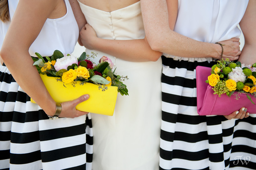 bridesmaids carrying floral clutches captured by Tara Whittaker Photography