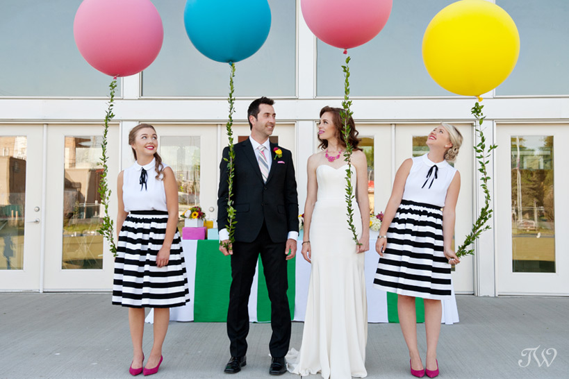 bridal party carrying giant balloons captured by Tara Whittaker Photography