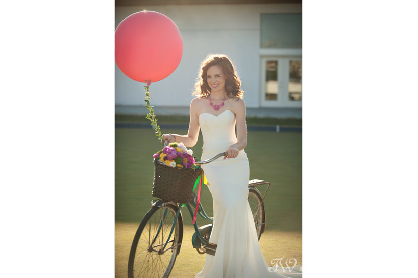 bride poses with a vintage bike captured by Tara Whittaker Photography
