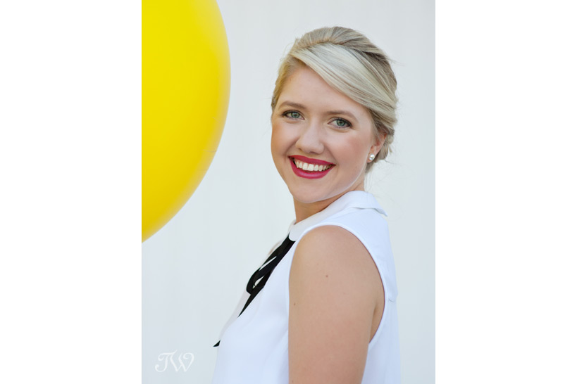 preppy bridesmaid with a yellow balloon captured by Tara Whittaker Photography