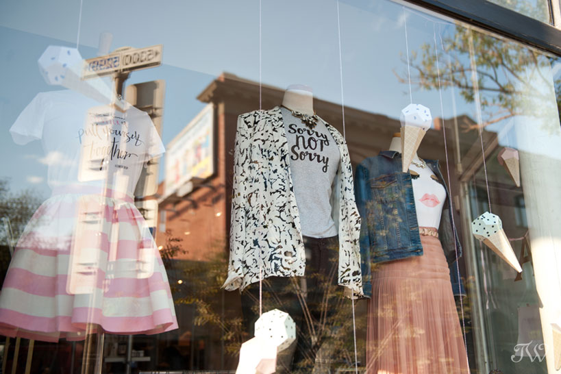 graphic tees in the window at Adorn Boutique captured by Tara Whittaker Photography