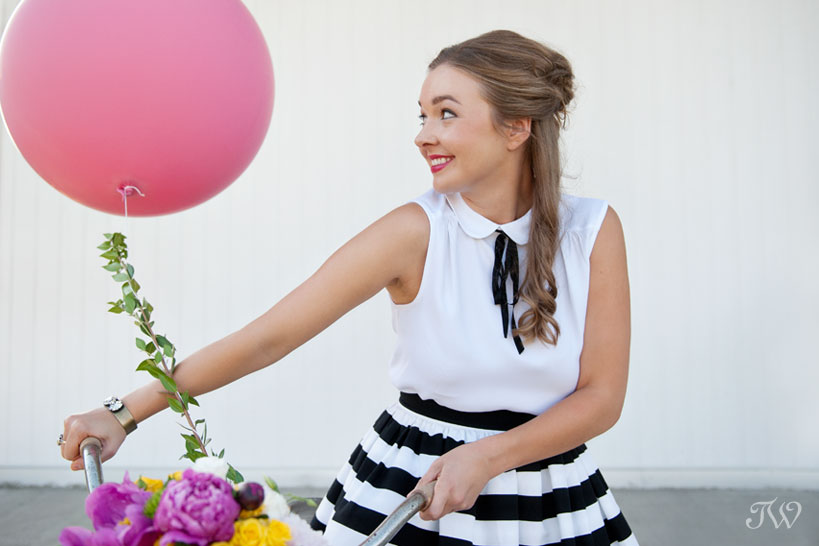 preppy bridesmaid with a pink balloon captured by Tara Whittaker Photography