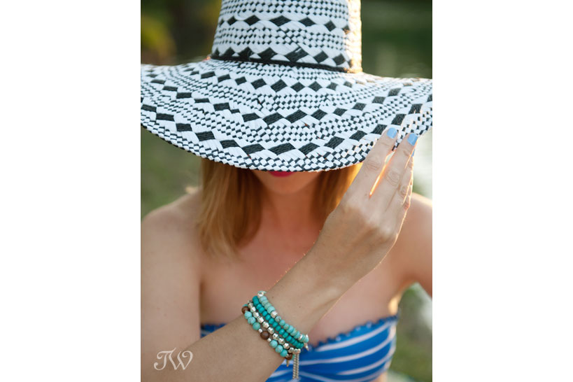 model wearing a wide-brimmed hat and bikini captured by Tara Whittaker Photography