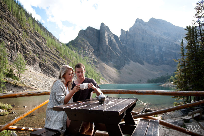 Couple toasting at Lake Agnes captured by Tara Whittaker Photography